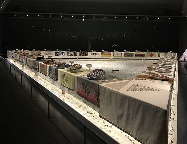 An overview of the complete Dinner Party installation by Judy Chicago. Each panel represents women who history has forgotten. Beginning with the mythical and ending with the contemporary